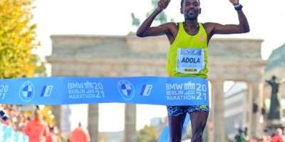 Ethiopia's GuyeAdola wins the men's Berlin Marathon title on Sunday.  By Tobias SCHWARZ (AFP)