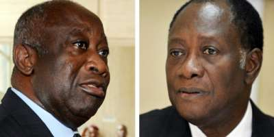 Former rivals: Gbagbo, left, and Ouattara.  By ISSOUF SANOGO, KAMBOU SIA (AFP)