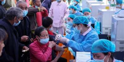 People receive Covid-19 vaccines in China's southwestern city of Chongqing.  By STR (AFP/File)