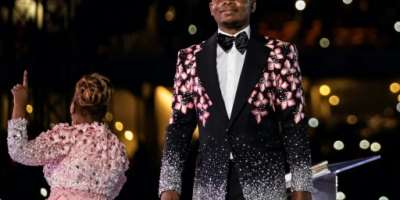 Shepherd Bushiri, seen here on stage with his wife, Mary Bushiri, at a stadium in Soweto on New Year's Day.  By WIKUS DE WET (AFP)