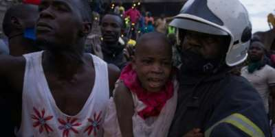 Two girls aged five and nine were found alive and taken to Kampala's main hospital.  By KATUMBA BADRU SULTAN (AFP)