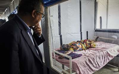 WHO Director-General Tedros Adhanom greets an Ebola patient at a treatment center in North Kivu, DRC. - Source: Hugh Kinsella Cunningham/EPA-EFE