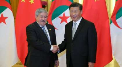 Chinese President Xi Jinping shakes hands with then Algerian prime minister Ahmed Ouyahia in Beijing in 2018.  By Lintao Zhang (POOL/AFP/File)