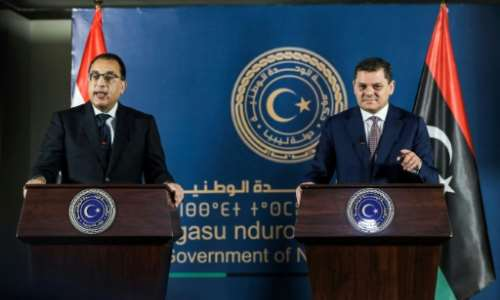 Egyptian Prime Minister Mostafa Madbouli, left, and interim Libyan Prime Miniser Abdulhamid Dbeibah hold a joint press conference in the capital Tripoli.  By Mahmud Turkia (AFP)
