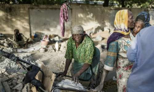 Idjele, 38, has been crushing gravel for three years to provide for her six children.  By MARCO LONGARI (AFP)
