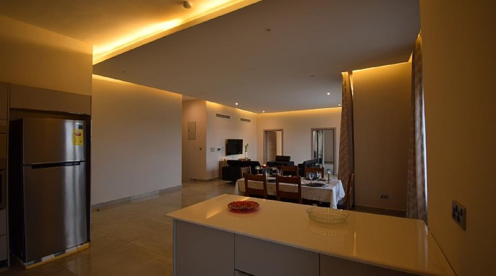 2 BHK Living Room from Kitchen.JPG