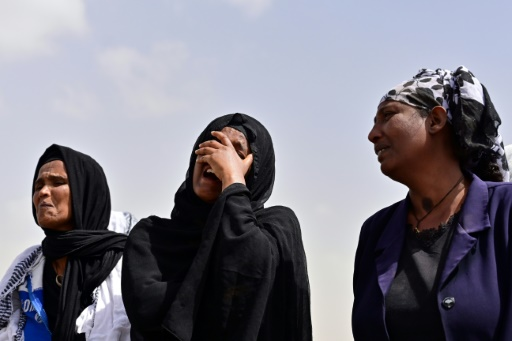 Bereaved Seek Answers At Plane Crash Site