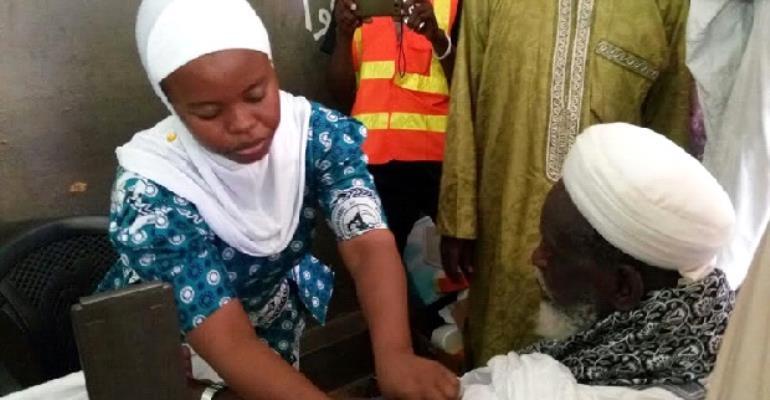A Muslim nurse attending to the National Chief Imam, Sheikh Osman Nuhu Sharubutu