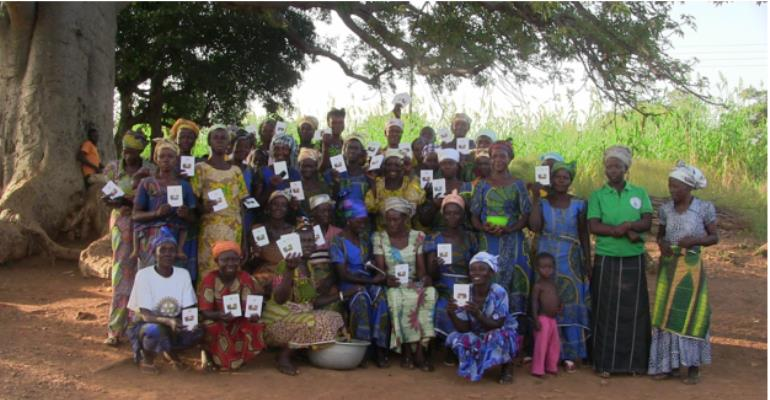 Some  members of the  Village Savings and Loan Association holding their saving cards in group picture
