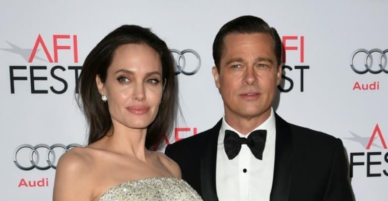 Angelina Jolie, Brad Pitt agree to settle divorce in private