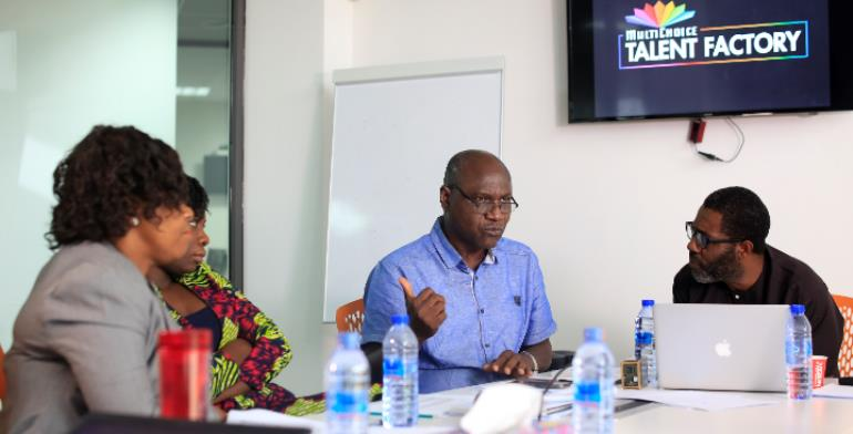 Prof Linus Abraham Donates Books To MultiChoice Talent Factory Library