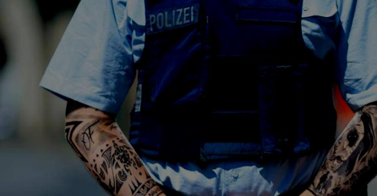 German Court In Bayern Confirms Ban: Policeman Must Not Be Tattooed