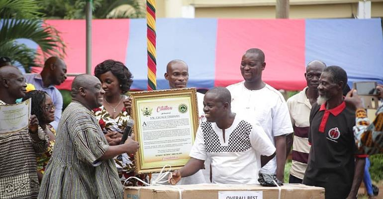Mr. Kingsley Agyei Boahene (left) Presenting the citation to Mr. George Freeman