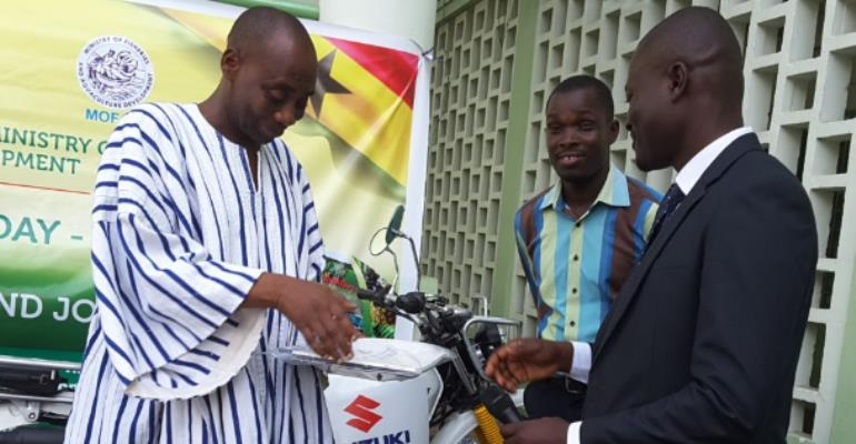 Mr. Julius Akyeampong (right), Brand Manager for Suzuki by CFAO presenting the motorcycle to the deputy minister of Agriculture, Dr Sagre Bambang
