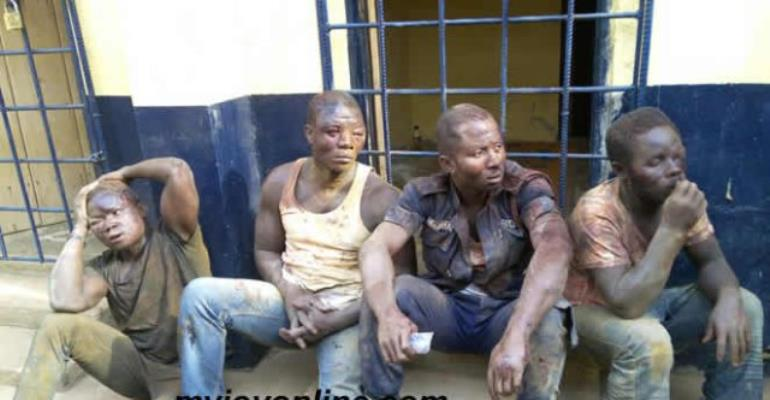 Two police officers arrested after 'escorting robbers'