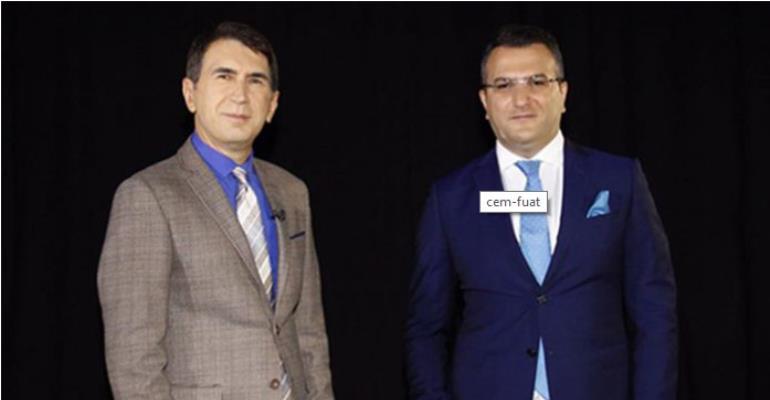 Journalist Cem Küçük (R) and Fuat Uğur