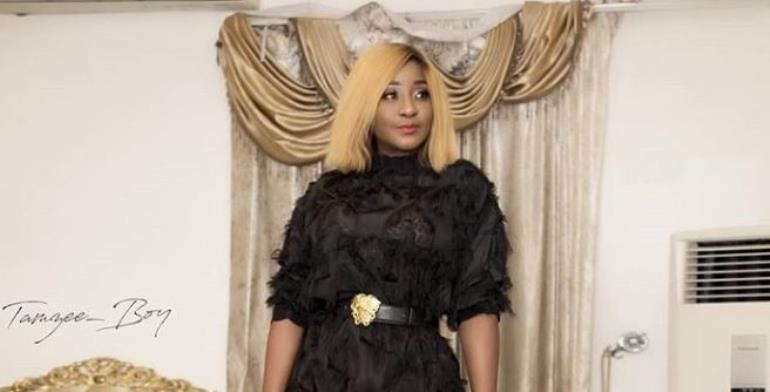 Nollywood actress, Ini Edo Looks Stunning in Stylish Feather Outfit