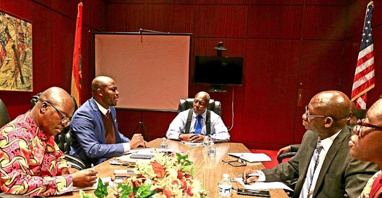 Amb Bawuah (heads table) Mr. Dickson to his left