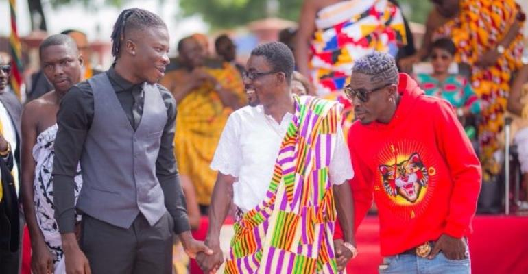 CEO of Zylofon Media, Nana Appiah Mensah (in Kente) with some of his signees, Stonebwoy, Shatta Wale