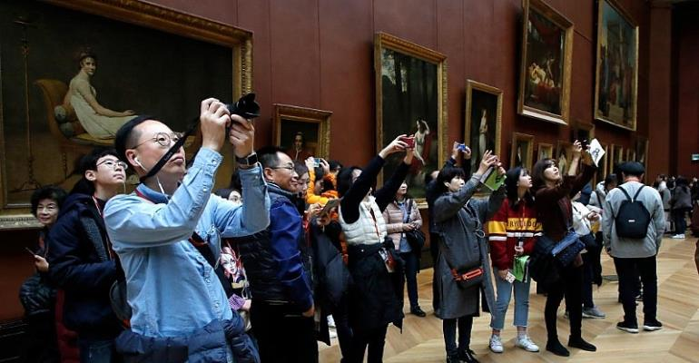 Beyonce helps Louvre break visitor record