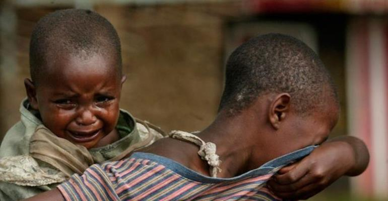 Suffering African children taking the responsibilities of their parents