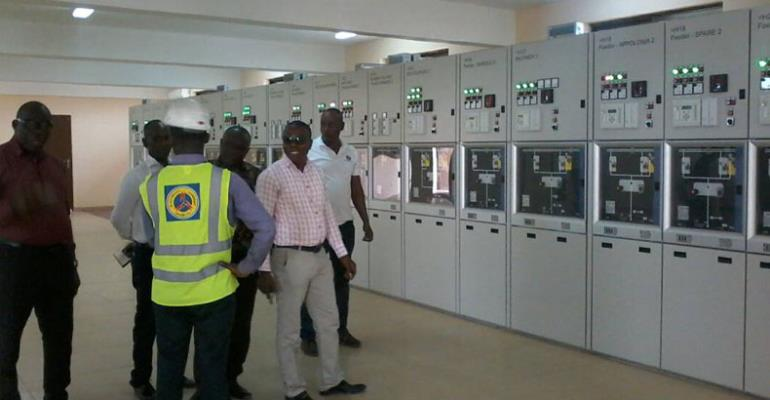 Some officials of ECG inspect the engine room of the new facility