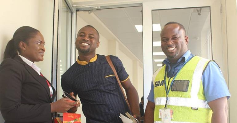 Staff of Ghana Airport presents chocolates to Abeiku Santana  on Val's Day