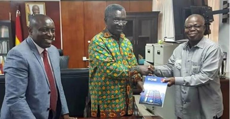 Ing. Kwabena Agyei Agyepong, Executive Director of GhIE (L) Ing. Steve Amoaning-Yankson, President of GhIE (right), presents the document to Professor Kwabena-Frimpong Boateng,