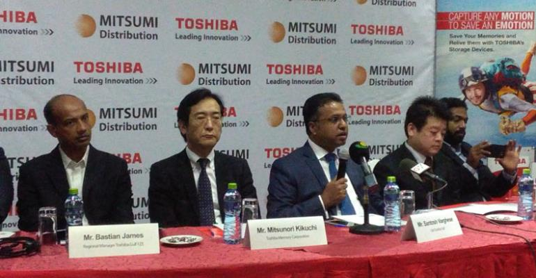 Santosh Varghese (middle), flanked by other officials of Toshiba, addressing journalists