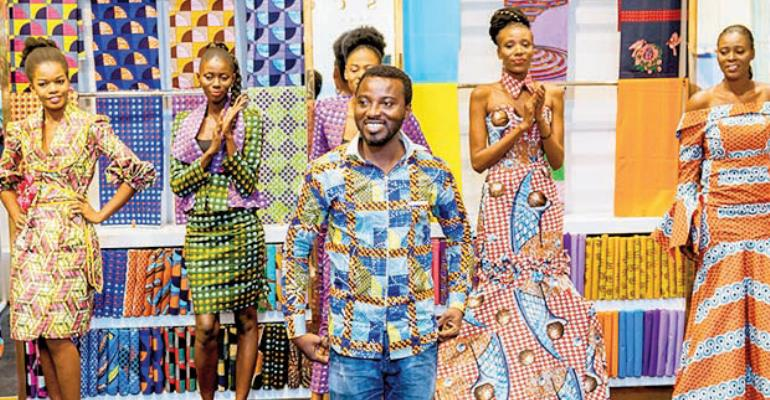 Samson with the model showcasing the new capsule collection at the Vlisco Shop at the Accra Mall in Accra