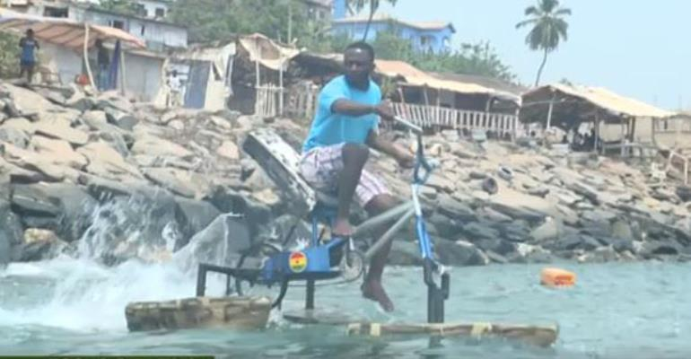 The inventor riding the bicycle on water