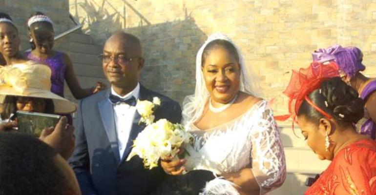 Irene Naa Torshie Addo in a group photograph with her husband and some invited guests at the ceremony