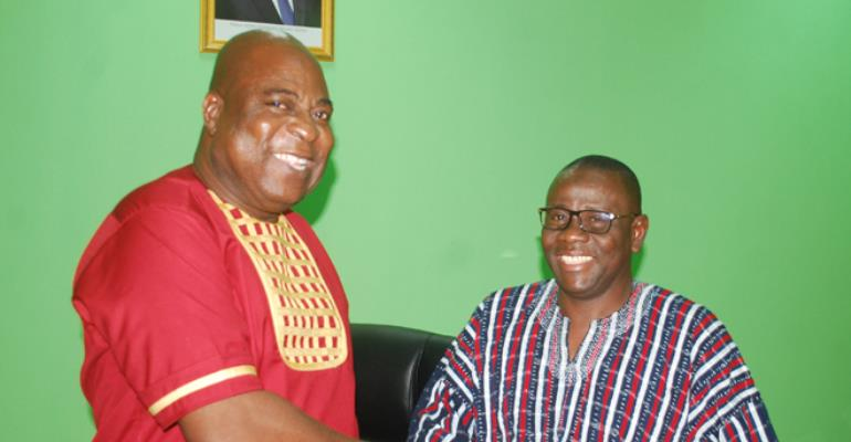 Ishmael Ashitey in a handshake with the MCD,Alhaji  Hanina Salam
