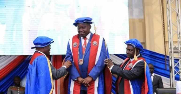 President Nana Akufo-Addo during the induction ceremony urged the new UEW Vice-Chancellor Prof. Anthony Afful Broni (M), to build bridges of reconciliation.