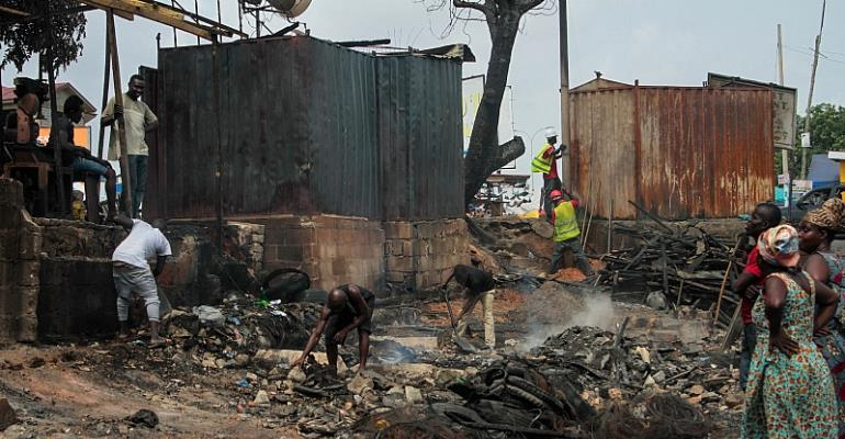 Victims Of The Devastating Fire Sifts Through The Smoldering Rubble