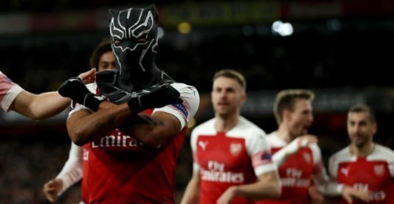 Arsenal's Pierre-Emerick Aubameyang celebrates scoring their third goal wearing a Black Panther mask. Photograph: Shaun Brooks/Action Plus via Getty Images