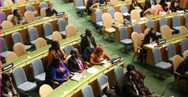 Picture by R. Harry Reynolds shows Ms. Otiko Djaba( in kente cloth) reading her address at the UN General Assembly.