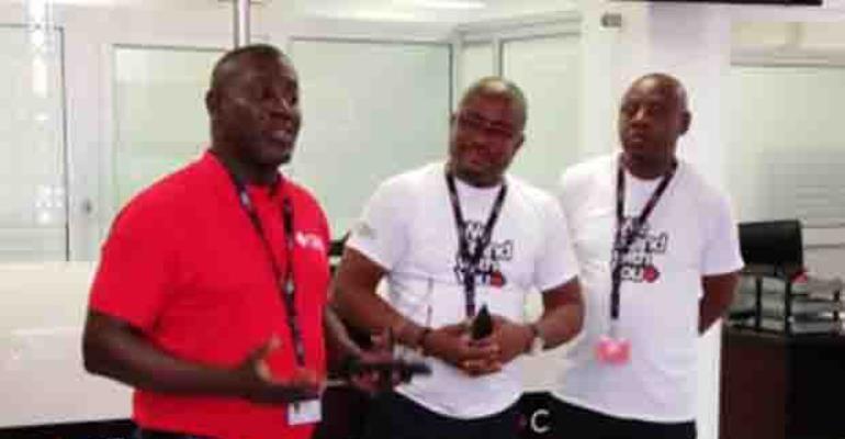 Daniel Wilson Addo (left) addressing customers