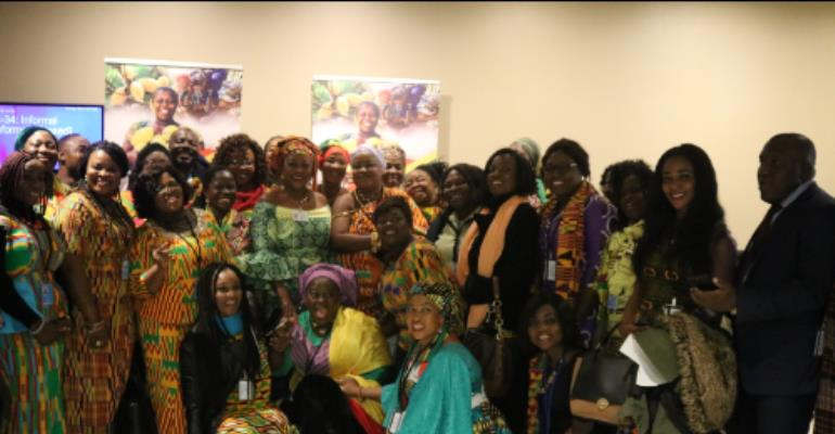 Ms. Otiko Djaba in a group with some members of Ghana's delegation