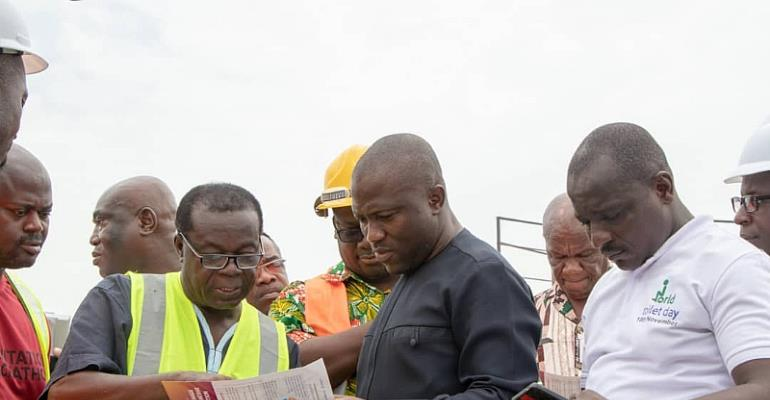 Mohammed Adjei Sowah meets the project Engineers to inspect the project