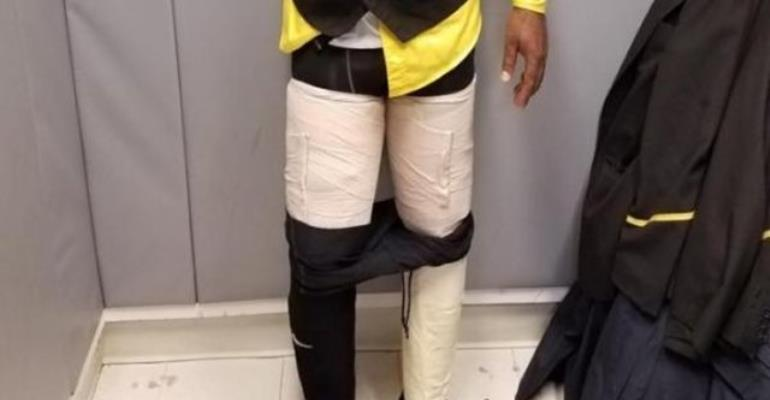 Flight crew member found with cocaine taped to legs