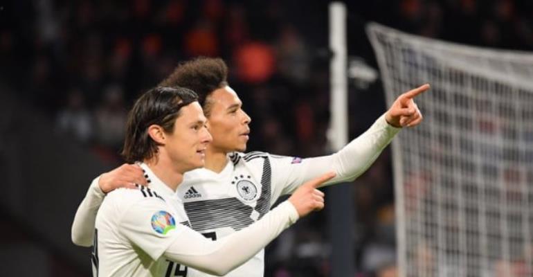 Leroy Sane (right) of Germany celebrates with teammate Nico Schulz. Photograph: Sebastian Widmann - UEFA/UEFA via Getty Images