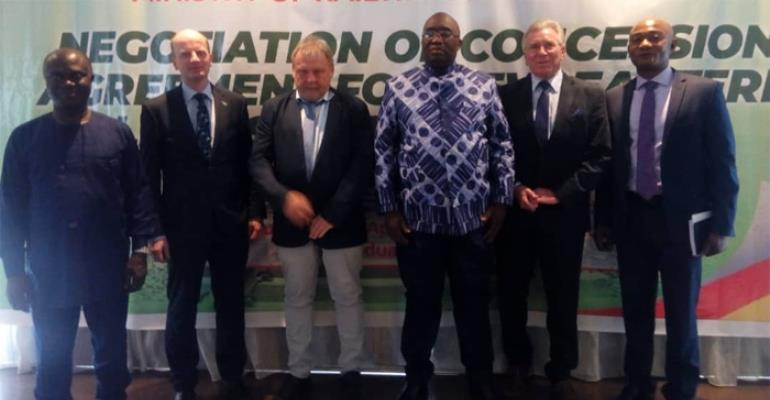 Joe Ghartey (3rd right) in a photograph with the investors, Prof. Baffour and his deputy