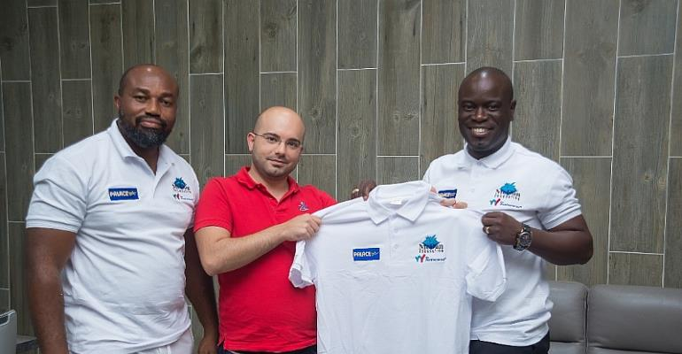 Ahmad Ezzedine CEO of Palace Decor(2nd L) and Attoh displaying one of the customized shirts for the tourney. With them is Dr. Daniel McKorley