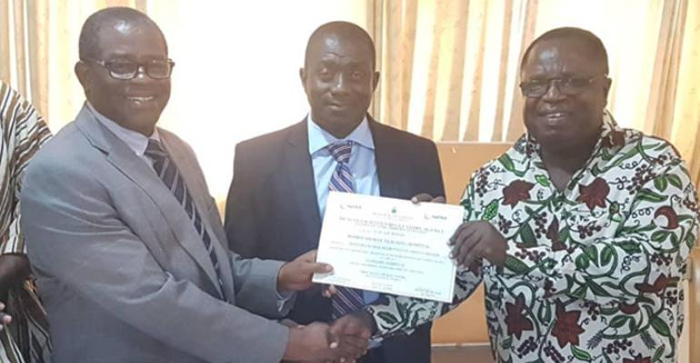 Dr. Oheneba Danso (middle) receiving the HeFRA certificate from Nana Otuo Acheampong