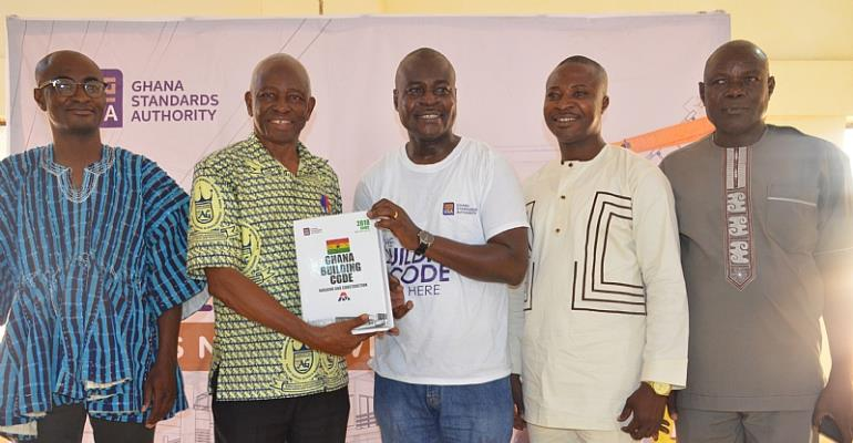 Prof. Dodoo, Director-General of the GSA (middle), presenting the first copies of the Code to Prof. Abole, MCE of the Bolga East District Assembly