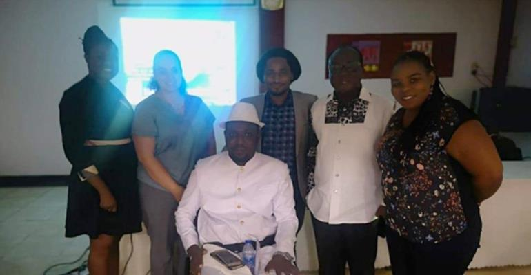 Some neurosurgeons with a cured patient and NPP Chairman, Freddie Blay