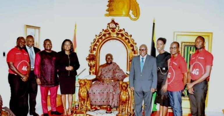 Asantehene Otumfuo Osei Tutu II in a group Photograph with the Vodafone team