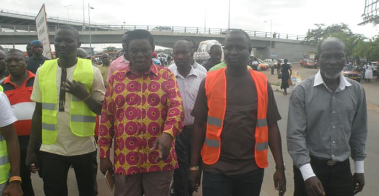 Moses Abor accompanied by staff and the leaders of the Hawkers Groups