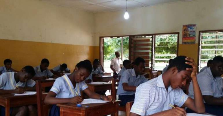 Pupils writing the B.E.C.E